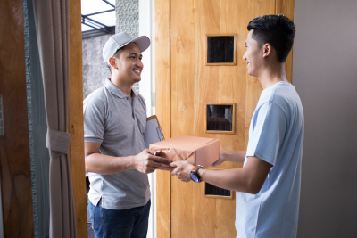 man receiving a package at home from the delivery guy
